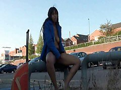 Naughty Sheronda flashing and masturbates outdoors