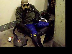 Gasmask smoking skinhead with blue rubber pants wanking