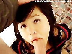 Chinese babe gives a blowjob to a huge cock