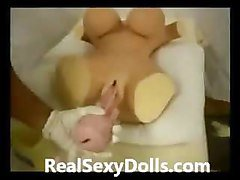 Inserting a Fleshlight into Sex Doll