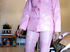 asian in light pink pvc jacket and pink leather pants