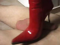 hot girl does nice shoejob with red boots