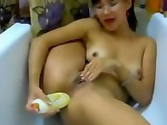 skinny asian mature shampoo bottle in her ass