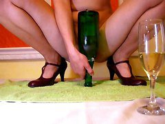 Slim Woman Shoves Full Size Wine Bottle In Eager Pussy